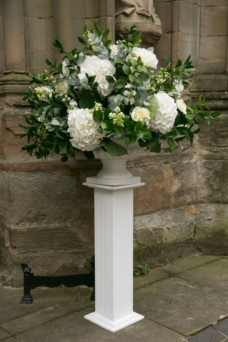 Stunning High White Floral Arrangement to put around your venue!