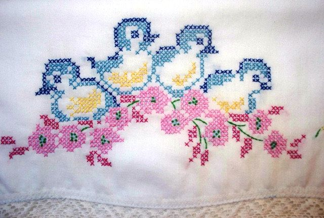 Adorable Vintage Pillowcase with Cross Stitch Bluebirds and Pink, Yellow Flowers, Crochet Trim, Hand Embroidery, 1960. $18.00, via Etsy.