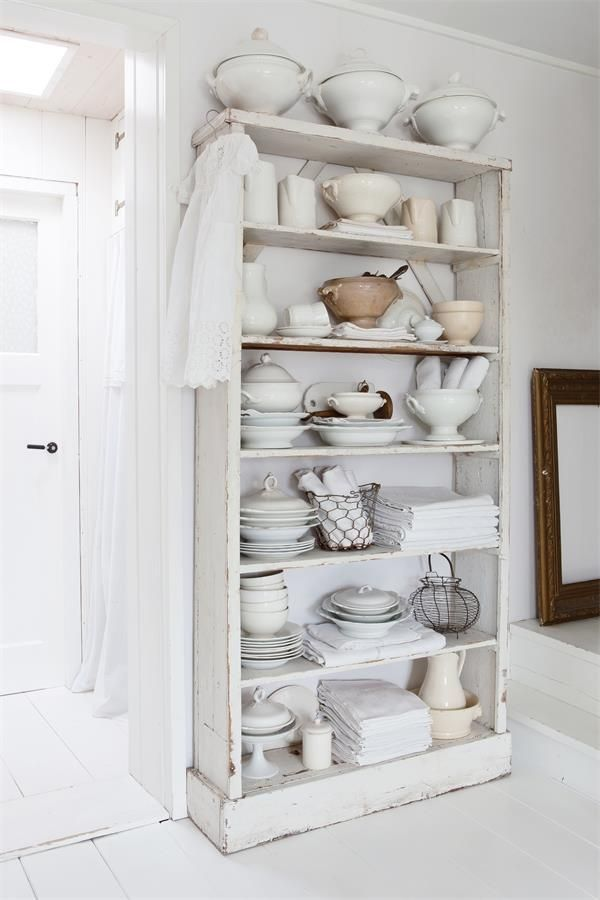 open cupboard with white