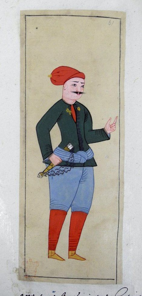 Azeb. A marine. Green tunic, blue knee-breeches, red stockings, yellow ankle boots. Knife (kârd) in a scabbard is attached to his blue sash by a cord. Red cap with small brim and full crown (barata).