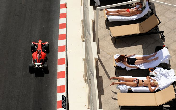 On my bucket list: Attend the prestigious Formula 1 Grand Prix of Monaco. People sunbathe as Ferrari Brazilian's driver Felipe Massa drives at the Monaco racetrack on May 21, 2009 in Monte Carlo, during the second free practice session of the Monaco Formula One Grand Prix. (PASCAL GUYOT/AFP/Getty Images)