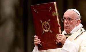 Pope Francis holds the gospels during the Christmas Eve mass at St Peter's Basilica