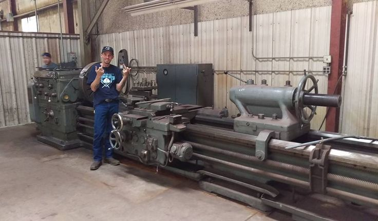 """Is this lathe """"tiny"""" enough for building axles for tiny homes? Trailer Made's own Brandon T. Posing next to this ww2 Era behemoth.  #biggiantlathe #tinyhousenation #tinyhouses #tinyhousemovement #tinyhousetalk #thow #tinyhouse #tinyhousenewsletter #tinyhousebuild #tinyhouseoregon #portland #portlandtinyhouse #sandiegotinyhouse #motherearthnews #tinyhome #tinyhomebuild #tinyhomeonwheels #tinyliving #tinyhouseproject #tinyhouseblog by trailermadetrailers"""