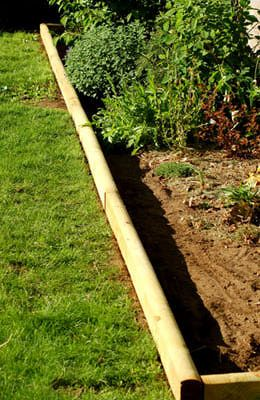 Picture: the finished installation of landscape timber edging.