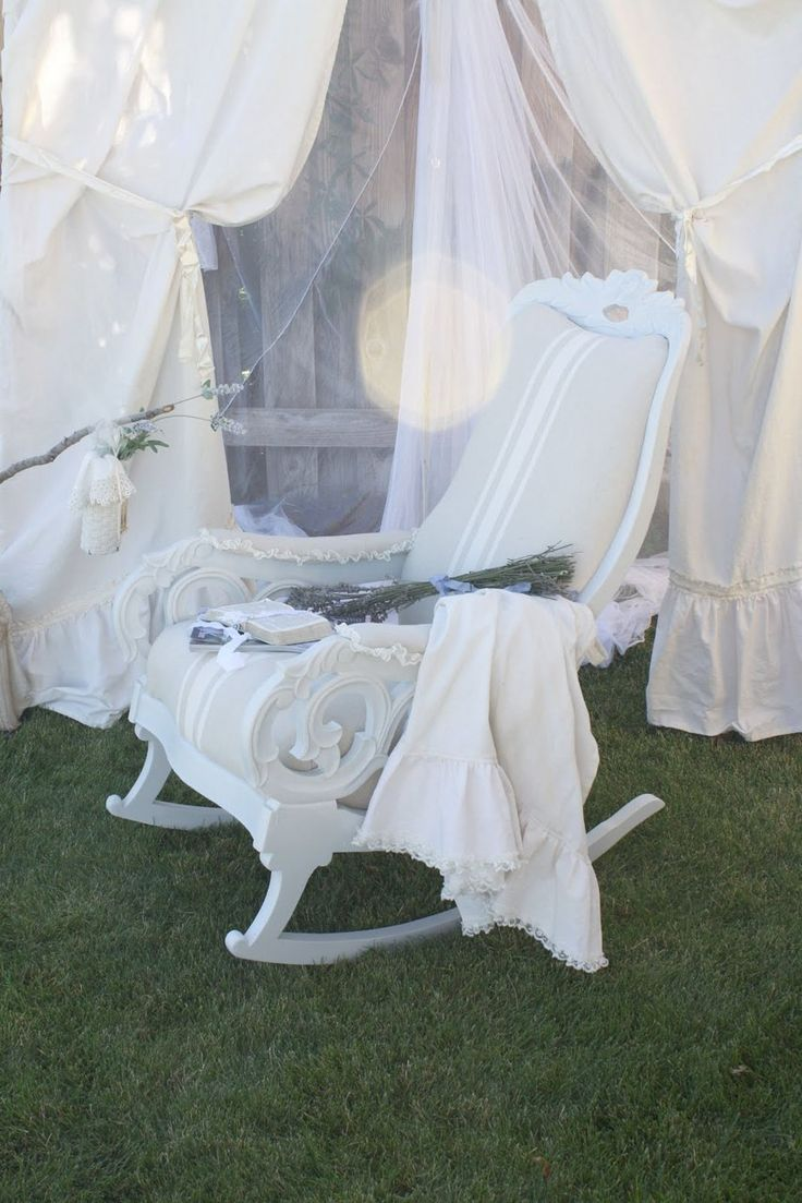 Set of armchairs and rocking chairs just out from beneath the shelter - It Will Have To Be A White Rocking Chair A Must