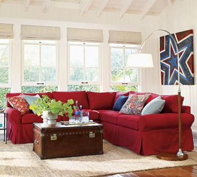 This is my exact red couch. I could lighten my family room by hanging mirrors behind main section, and putting light rug on the floor.