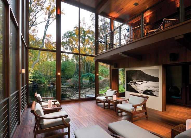 Huge windows in an open room, sigh. It just needs cozy furniture instead if stiff chairs.