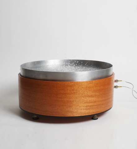 Speaker with a bowl of water that vibrates.
