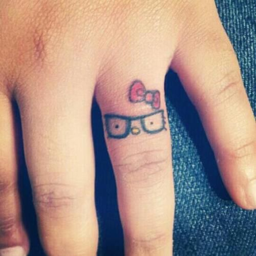 Cute little nerd Hello Kitty tattoo, I am not normally a hello kitty fan I must admit but this one I like!