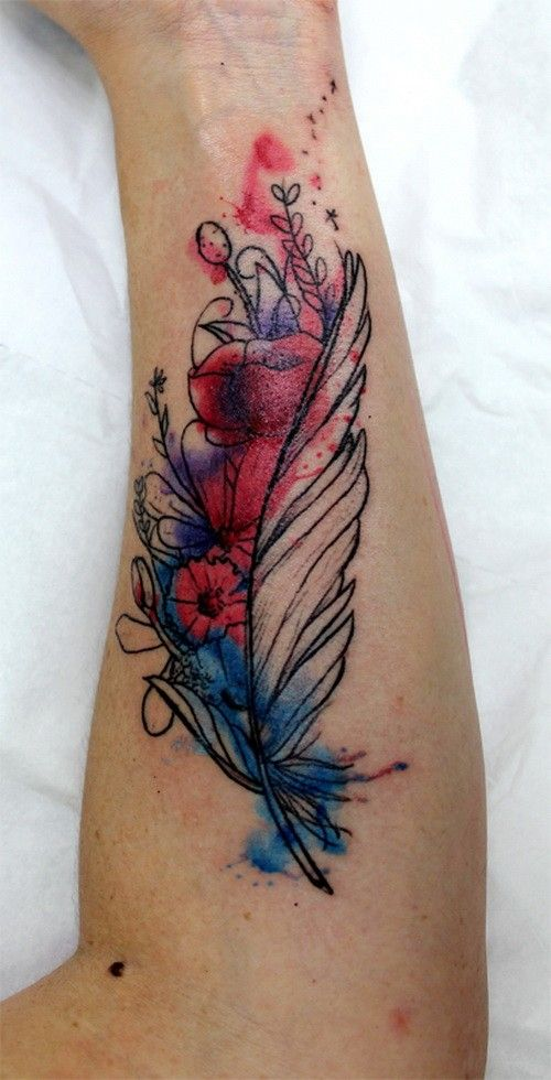 Amazing colorful feather with flowers tattoo on arm