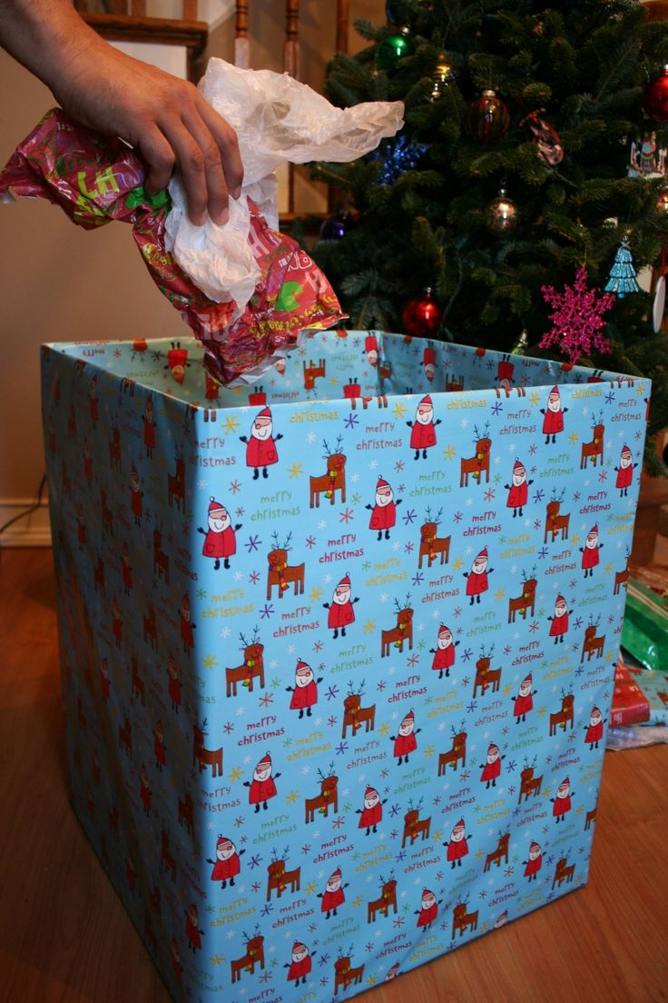 I like this! A wrapped empty box (left open) for Christmas morning trash/recycle. You see the box instead of a big garbage bag in pics