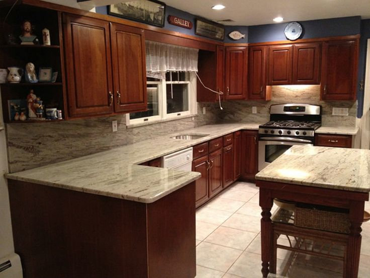 River white granite countertop river white granite for Cherry and white kitchen cabinets