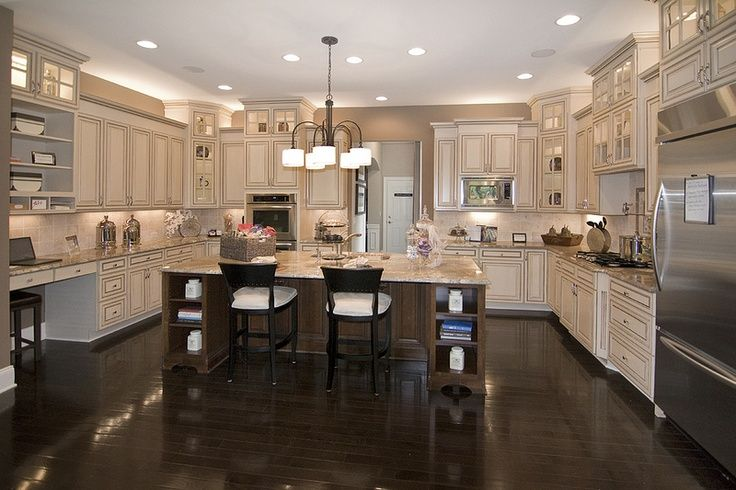 Dream kitchen almond cream kitchen cabinets with for Kitchen cabinets with dark floors