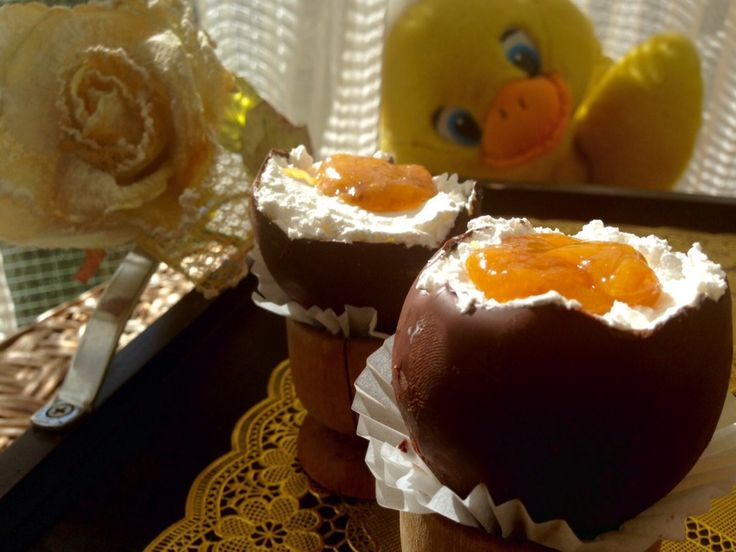 """""""Soft boiled egg"""" - Cheesecake Filled Chocolate Easter Egg Cups Though it looks like an easter egg, this no bake dessert is actually chocolate pastry filled with whipped vegan cream and a 'yolk' made of passionfruit sauce mixed with apricot jam...a true delicacy!"""