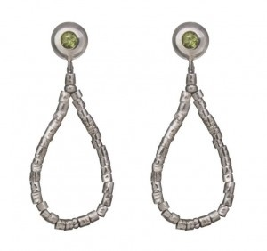 Chaquira  Sterling Silver dangling earrings from the Kamari Collection are made with tubular Chaquira beads. The beads were once used by ancient Peruvians in adornments that denoted royalty. Accented with ear buttons, these are featured with peridot gems. #silver jewelry #silver earrings