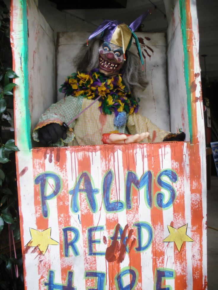 Halloween CarnEvil Palms Read/Red Booth 2015; free cardboard frig box, packing tape torso filled with plastic bags, 99C Store cotton gloves & plastic severed hand, killer clown mask, yard sale clown suit, feather collar & jester hat, paint. Total cost: under $25 (punkineater on Halloween Forum)