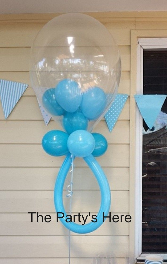 Baby Rattle Balloon. Helium filled with a weight attached. Perfect for next to your candy buffet, cake table, gift table or entrance. This will definitely have your guests amazed at how we make these, fantastic talking point! #balloons #decoration #babyshower #baby #blue #dummy #babyboy