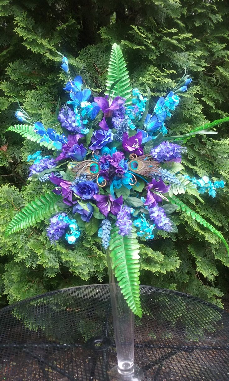 Towering Peacock Centerpiece #peacockwedding #silkflowers #centerpiece #justimaginebyk.com
