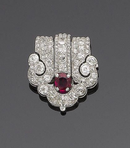 An art deco ruby and diamond clip brooch, by Cartier,