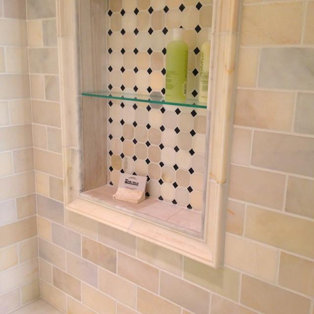 Glass Shelf In Shower. Marble Backsplash. Bathroom