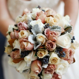 Rustic wedding flowers  I like the bluey white leaves in centre..goes well with colours
