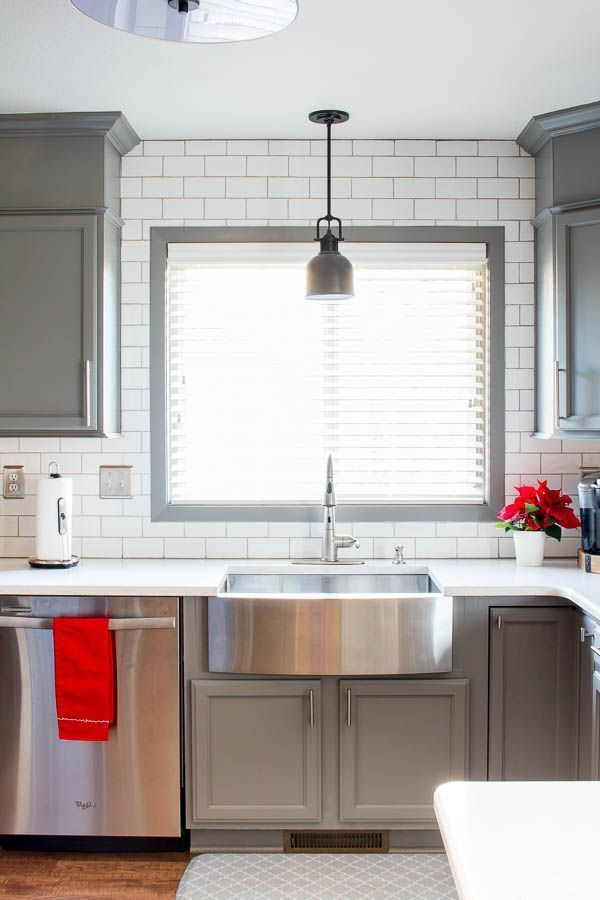 Home Decorating DIY Projects  :     A builder grade kitchen gets a new look with classic features like gray cabinets, Quartz counters and subway tile. A must see makeover!    -Read More –   - #DIY https://decorobject.com/diy/home-decorating-diy-projects-a-builder-grade-kitchen-gets-a-new-look-with-classic-features-like-gray-cabinets-5/