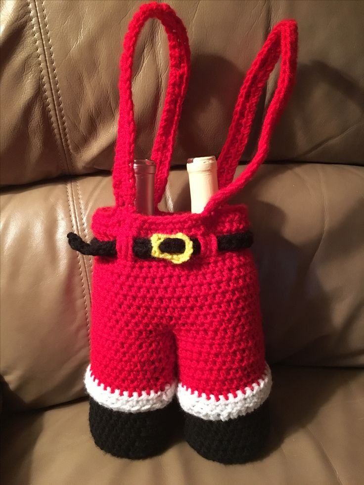 """Crocheted Santa Pants Wine Holder. This is 7"""" x 17.5"""" including suspenders. These measurements are with the wine bottles inside. Crocheted by Sandy Johnson November 2017."""