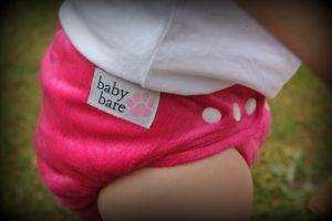 Modern cloth nappies make a great outfit all on their own through the summer months. Adore this hot pink Baby Bare nappy www.babybare.com.au