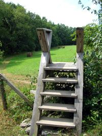 sturdy stile with railings is in a scenic pastoral setting in Pennsylvania Sue's AT Journal