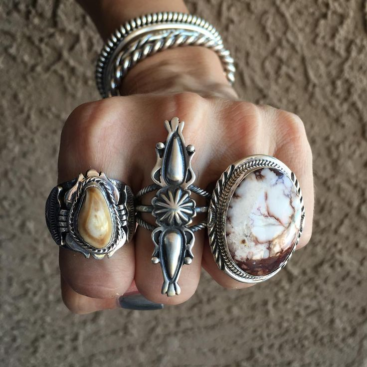 Rustic Flair! Loving these killer Elk Ivory and Wild Horse rings - paired with solid silver stacker cuffs. Find these in our shop. DM with additional questions. • • www.sunfacetraders.com • • ➖➖➖➖➖➖➖➖➖➖➖➖➖➖ #SunfaceTraders #NativeAmericanJewelry #navajojewelry #royston #gemstone #turquoise #squashblossom #accessories #cowgirl #rodeo #VintageStyle #bohostyle #Authentic #handmade #designer #jewelry #western #Arizona #fashion #cowgirlstyle #countrywedding #turquoisejewelry #silvernecklace…