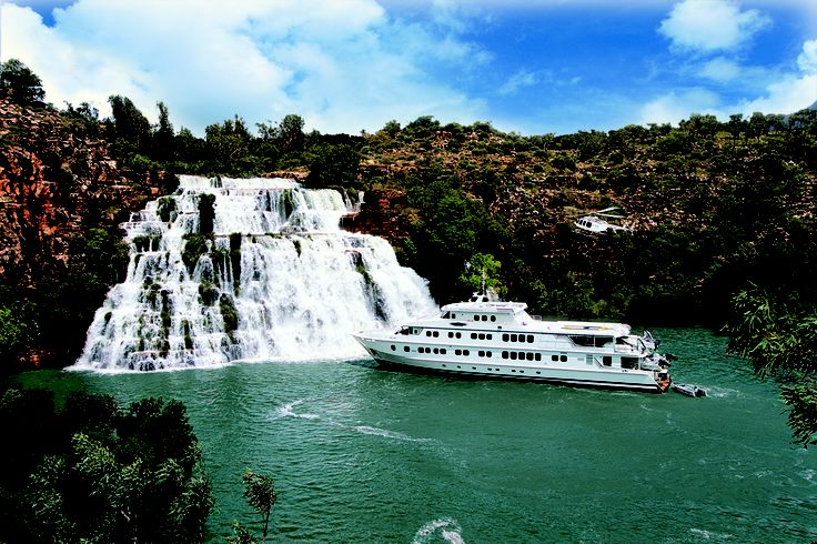 Cruising The Kimberley, TRUE NORTH at the majestic King Cascade, Prince Regent River the Kimberley. #thekimberley #kimberleycruises #broome #waterfalls #boats