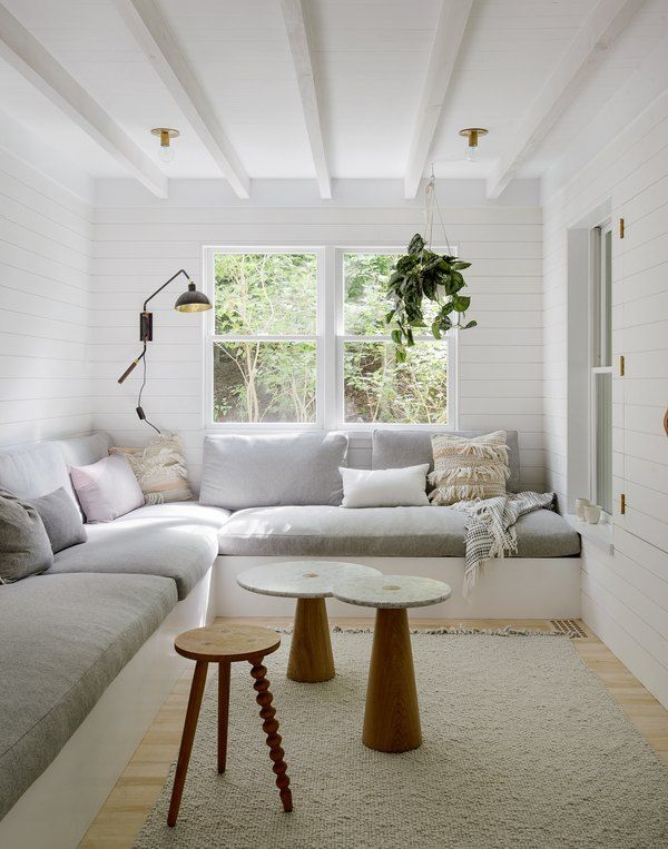 Scandinavian Beach House Chic Is Our New Favorite Look Hunker In 2020 Built In Sofa Living Room Scandinavian Beautiful Living Rooms