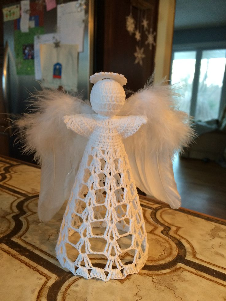 Crocheted angel with feather wings