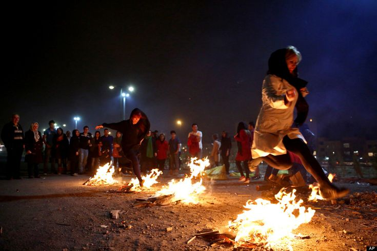 Celebrating Charshanbe Suri by jumping over bonfires, at the end of winter, as a prelude to Nowruz, the Iranian New Year.
