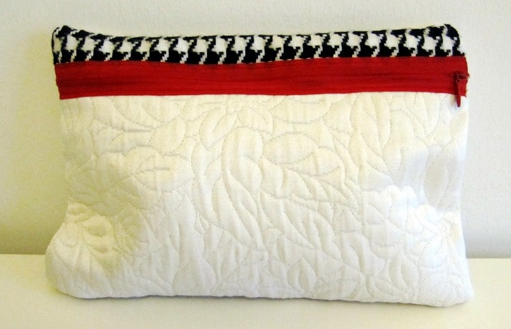 Clutch bag, combining classic gobelin fabrics with bold red zipper. (May 2012)