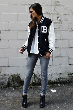 Blogger Tilden B wears a varsity inspired look with letterman bomber jacket and…