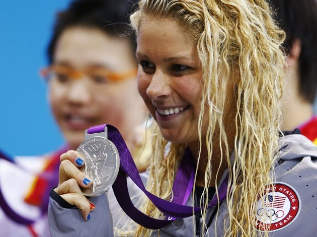 Elizabeth Beisel of the U.S. poses with her silver medal during the women's 400m individual medley victory ceremony at the London 2012 Olympic Games at the Aquatics Centre July 28, 2012