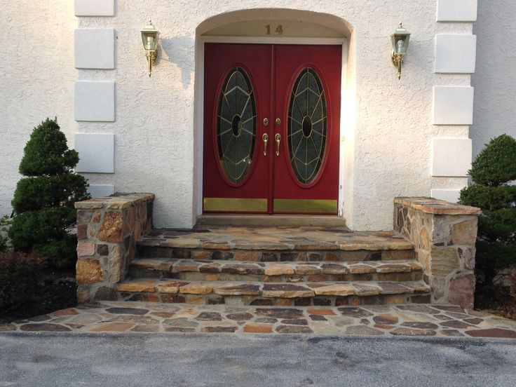 Stepping Stone Entry  Randomly placed stepping-stones crafted from local granite lead to the front porch's wide steps. Description from pinterest.com. I searched for this on bing.com/images