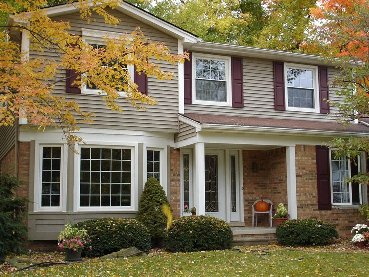 Bay windows stone exterior | Astonishing Exterior Home Decoration With White Wood Marvin Bay Window ...