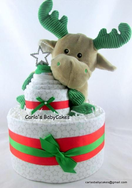 Listing is for this Reindeer diaper cake with a receiving blanket cupcake topper Contents 30 Disposable diapers (size 1) 2 Receiving blankets (30 x 30 inches) 1 Infant washcloth 1 Plush reindeer stroller toy Your baby shower decoration arrives wrapped in tulle, adorned with