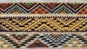 patterns with a dominant chevron shape that are either plain (Aramoana - ocean waves)