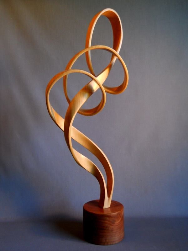 John McAbery Sculptures Hand Carved from solid blocks of wood.