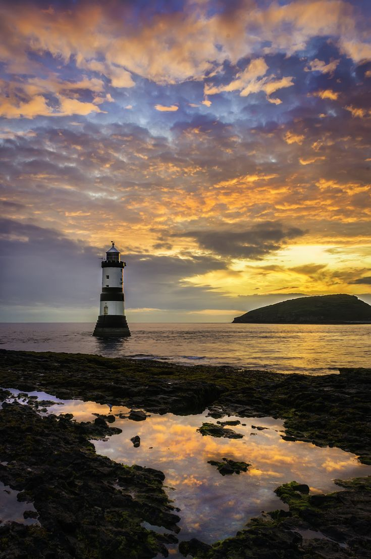 Trwyn Du Lighthouse is a lighthouse between Dinmor Point near Penmon and Ynys Seriol, or Puffin Island, south east Anglesey, Wales at the north entrance to the Menai Strait and marking the passage between the two islands. The tower has been unmanned since 1922 and is checked from Holyhead Control Centre. Photo: studio29design.co.uk