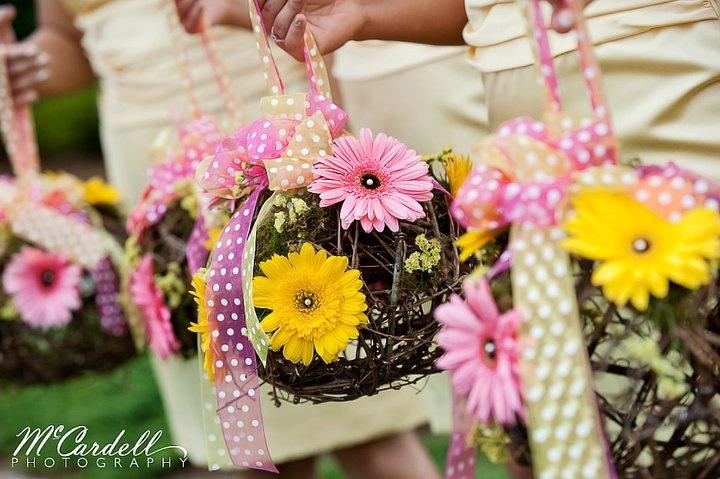 Precious grapevine bridesmaids' bouquets for a vineyard wedding.