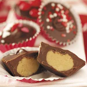 Ingredients  1 cup creamy peanut butter, divided  4-1/2 teaspoons butter, softened  1/2 cup confectioners' sugar  1/2 teaspoon salt  2 cups (12 ounces) semisweet chocolate chips  4 milk chocolate candy bars (1.55 ounces each), coarsely chopped  Colored sprinkles, optional