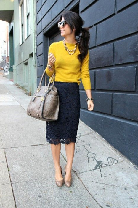 Master the effortlessly chic look in a mustard crew-neck pullover and a navy lace pencil skirt. Brown leather pumps will bring a classic aesthetic to the ensemble.  Shop this look for $141:  http://lookastic.com/women/looks/sunglasses-necklace-crew-neck-sweater-bracelet-watch-tote-bag-pencil-skirt-pumps/4612  — Black Sunglasses  — Gold Necklace  — Mustard Crew-neck Sweater  — Black Statement Bracelet  — Gold Watch  — Brown Leather Tote Bag  — Navy Lace Pencil Skirt  — Brown Leather Pumps
