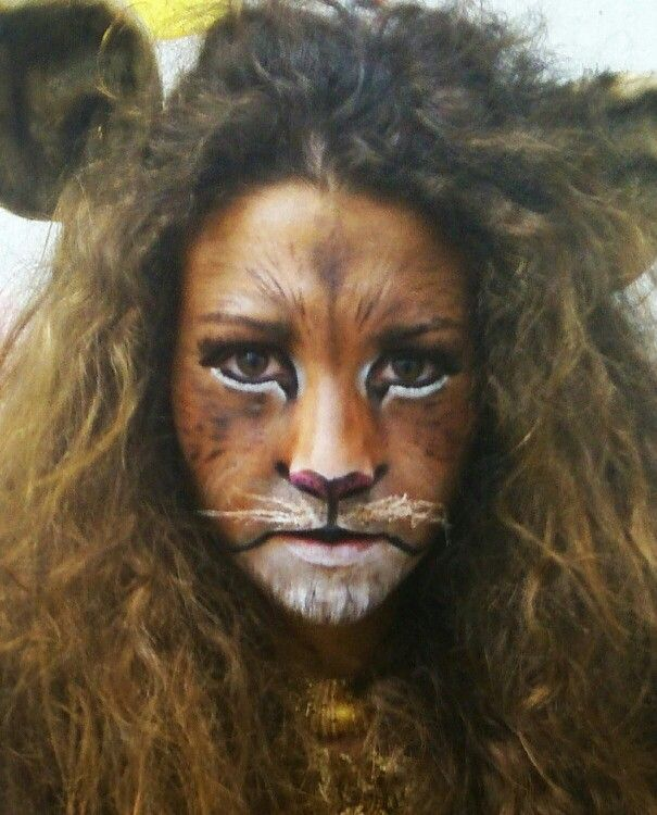 LION COMPLEXION - imitate the pattern and colours used within the face paint. Copy the whiskers and beard with white.