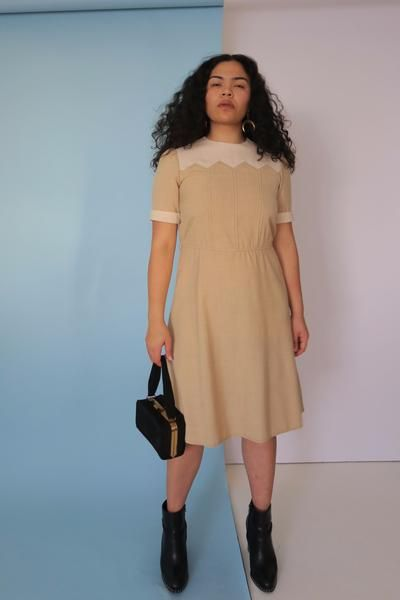 Cream Babygirl Dress - This vintage cotton dress is one of those pieces that is flattering on anyone. Super cute detail at neckline and sleeve, this neutral tone goes with anything.