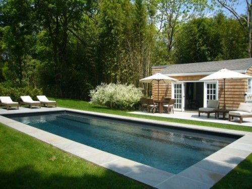 Pool with Concrete Border and Grass. Shingled Pool House.