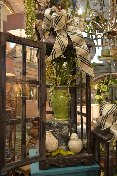 Love this urn inside this large lantern, topped with a beautiful bow!
